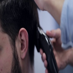 Barber shape up haircut white man with electric razor at barbershop, close-up. Stock Footage