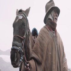 Peruvian peasant with his horse on winter day Stock Footage