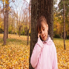 Kid talking on the phone in the park, Stock Footage