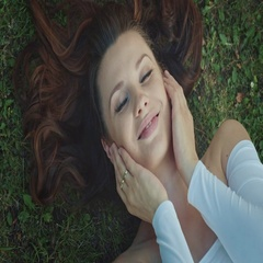 Young woman laying on meadow, slow motion clip Stock Footage