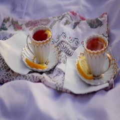 Lemon tea in cups at sunset Stock Footage