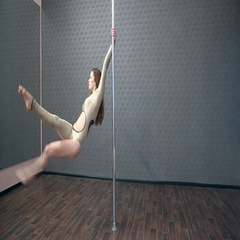 Girl in gold dancing pole dance Stock Footage