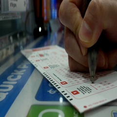 Woman hands filling lucky number on keno lottery ticket Stock Footage