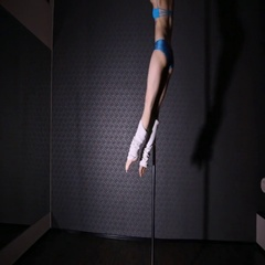 Girl in blue dancing pole dance Stock Footage