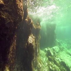 Underwater sea cliffs with crashing waves and sunlight in slow motion Stock Footage