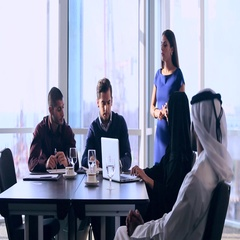 Group of colleagues applauding for businesswoman at conference room Stock Footage