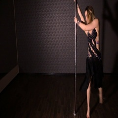 Girl in black dress dancing pole dance Stock Footage