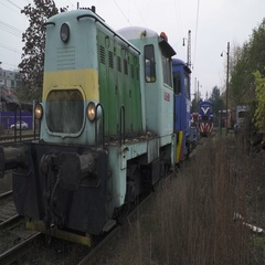 An a Old Green train wait until another blue train  Connect to it. Rail station  Stock Footage