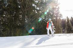 Woman snowboarder on the slopes frosty winter day Stock Photos
