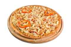 Pizza with paprika of cheese on wooden board. for a directory or menu Stock Photos