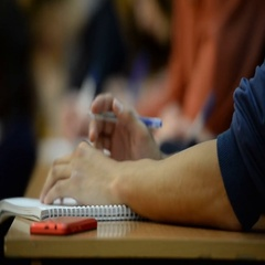 Students at the university in the classroom. Notebooks, pens, hands, close-up Stock Footage