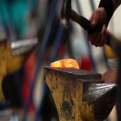 Blacksmith forges a horseshoe. Slow Motion. Stock Footage