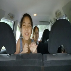 Slow motion of Happy Asian family on mini van are smiling Stock Footage