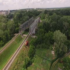 Quadrocopters takes the traveler on the train tracks freight train Stock Footage