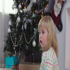 Little girl in pajamas surprised gift Stock Footage