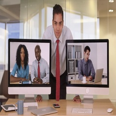 Business man giving bunny ear to colleague on computer screen and making faces Stock Footage