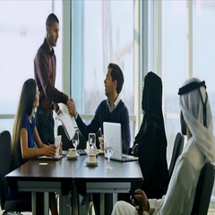 Business people greeting in conference room Stock Footage