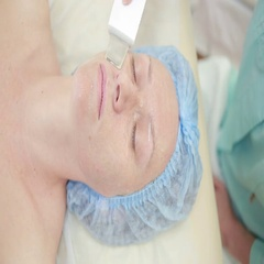 Receiving electric darsonval facial massage procedure. beauty parlor Stock Footage