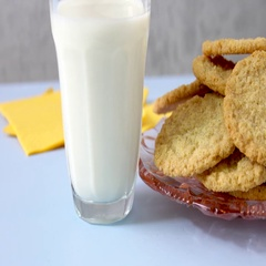 Oat cookies and a glass of fresh milk on a table in close up Stock Footage