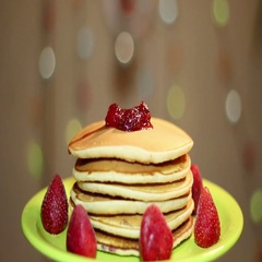 American pancakes with strawberries and jam . Stock Footage