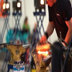 Blacksmith forges a horseshoe. Stock Footage
