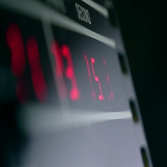 Electronic clock in dark room with red glowing digits Stock Footage