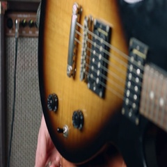 Guitarist plug cable in electric guitar Stock Footage
