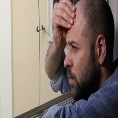 man deep in thought while looking out the window Stock Footage