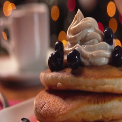 Mint syrup flows  on stack of pancakes Stock Footage