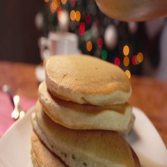 Strawberry syrup flowing on a stack of pancakes Stock Footage