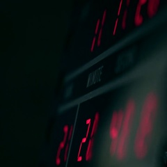 Digital clock in dark room with red glowing digits Stock Footage