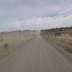 Off road 4x4 following motorcycle dusty desert road HD POV 033 Stock Footage