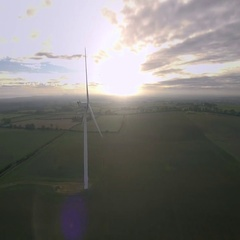 Wind power generator - sustainable energy concept. Aerial view Stock Footage