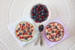 Two yogurt dessert with berries and almonds Stock Photos