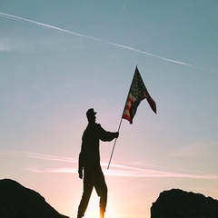 Soldier and American Flag Against Sunrise Sky. Slow Motion  Stock Footage