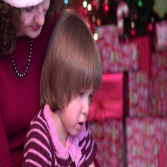 Mother and Daughter Reading Picture Book, new year, xmas, lights Stock Footage