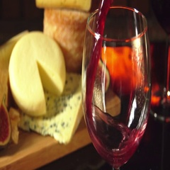 Cheese plate and glass of red wine Stock Footage