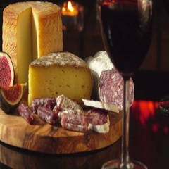 Cheese board, homemade sausage and glass of red wine Stock Footage
