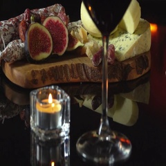 Candle on a table with Cheese board Stock Footage