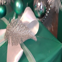 Green gift box with silver ribbon and bow, cam moves to the left Stock Footage