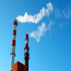 Boiler house chimney. Steam against the clear blue sky. Industrial zone of the Stock Footage