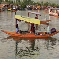 People use small boat for transportation in lake of Srinagar,  India Stock Footage