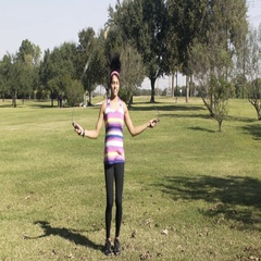 Slow motion walking to a young woman jumping rope in a park Stock Footage