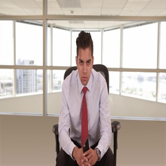 Portrait of young Hispanic business professional sitting in office chair Stock Footage