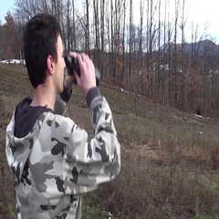Man using binoculars looking landscape area Stock Footage