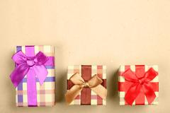 Holiday gift boxes on brown paper background Stock Photos