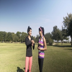 Twin sisters jogging in a local park 4k Stock Footage