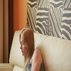 Woman on sofa using laptop in living room Stock Footage