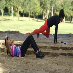 Twin sisters exercising in a local park Stock Footage