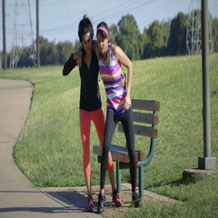 Woman helping her exercise partner get help from a leg injury Stock Footage